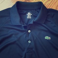 Lacoste Polo, never worn, black. This Lacoste Polo Sz 4. In Lacoste sizes that is a medium men's (or women's large). Never worn. Has very small snag by back of collar, as seen in picture. Otherwise like new. Black. Lacoste Tops Blouses