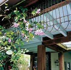 GOOD IDEA: Using old (or new) garden edging upside down along a porch as a trellis. Love this!!