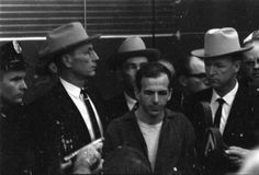 Lee Harvey Oswald in police custody at Dallas Police Department, 11/22/1963