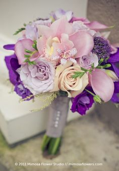 Bridesmaids Stylish purple and white beach wedding bouquet