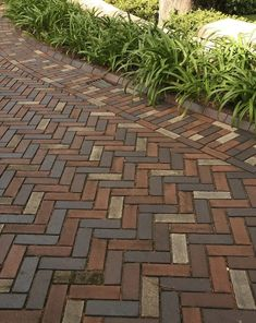 Herringbone paving is strongest for driveways & looks more interesting with random contrast pavers