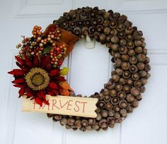"""Or use a ton of them for an <a href=""""http://www.somewhatsimple.com/glittery-acorns/"""" target=""""_blank"""">elaborate wreath</a>."""