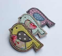 Very pretty fabric bird brooch