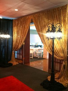 A red carpet and gold curtain for a grand entrance to a fabulous night.