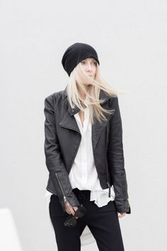 Figtny is wearing a black leather jacket from Kenya, shirt-dress from Aritzia, knit trousers from Zara and the cashmere hat is from Catbird
