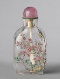 Snuff Bottle and Stopper  Flowering Cherry and Pine Trees with Butterfly    Made in China, Asia  Qing Dynasty (1644-1911), 1767-1860    Artist/maker unknown, Chinese    Colorless glass with enamel decoration; tourmaline and glass stopper with ivory spoon  2 3/8 x 1 3/16 inches (6 x 3 cm)    * Gallery 236, Asian Art, second floor, right-hand case    1944-20-580    Gift of Major General and Mrs. William Crozier, 1944