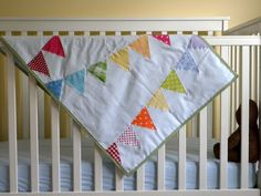 Rainbow bunting baby quilt tutorial. I have never quilted, but this might be the first project that makes me want to give it a try...