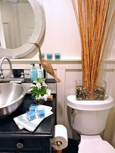 Coastal Cottage Powder Room: The coastal accents worked well with the permanent pieces.  See two other designs of this bathroom on the designHAPPY blog!