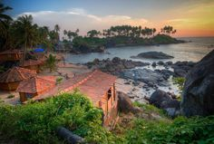 Top beaches in India - Palolem Beach, Goa Enclosed by a thick forest of coconut palms in south Goa, Palolem Beach, known for its dolphin-spotting tours, is arguably the state's most idyllic beach. Its southern end tends to be much busier while the northern stretch is comparatively quieter being surrounded by a picturesque island that you can walk out to during low tide.