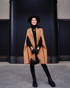 """Salma Masrour on Instagram: """"You can't go wrong with a black base 🖤 • Photo by @kaoutarbarhmii"""" Hijab Fashionista, Duster Coat, Goth, Normcore, Canning, Jackets, Base, Instagram, Style"""