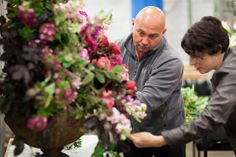 Alan Simpson from Hybrid preping his designs for British Flowers Week at New Covent Garden Flower Market
