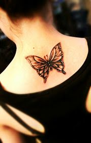butterfly tattoo with black and white color on the back