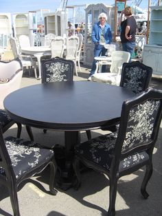 Black dining table and chairs upholstered in Waverly's Country House Toile fabric -- photo by Reese & Marie
