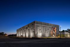 Gallery of National Archives Preservation Facility / May + Russell Architects - 1 Concrete Facade, Precast Concrete, Concrete Building, Industrial Architecture, Architecture Office, Amazing Architecture, Warehouse Design, Concrete Finishes, Dawn And Dusk