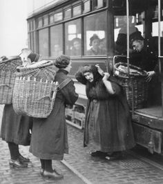 c.1940's. To the Creel. Fisherrow,(Musselbrough), Fishwives and their baskets. Putting creels on the tram. 1940s.