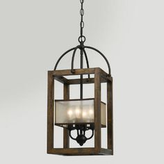 We love the Southwestern vibe of our Mission Chandelier. This four-shade light fixture has a wood and metal design with a bronze and red-brown finish that's reminiscent of classic styles.