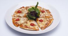 """These pita pizzas will bring out your inner """"Paesano."""" They're low in calories & high in protein unlike traditional varieties."""