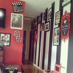 This is what my house will look like! Black and white stripped and red walls and pictures everywhere