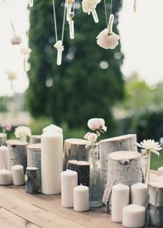Candles  and natural/wooden elements + hanging flower tubes.