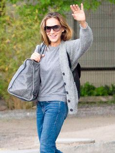Sarah Jessica Parker kept her look casual in Chile with jeans and a gray sweater, topped off with shield shades!