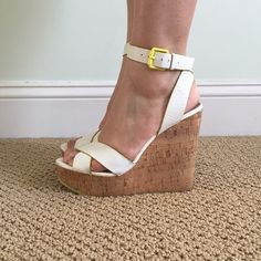 ALDO White and Yellow Accented Cork Wedge Heel FINAL PRICE DROP! These ALDO wedges are perfect for any spring and summer occasion. These have been worn a few times and have received rave compliments each time they made an appearance!! In great condition! ALDO Shoes Wedges