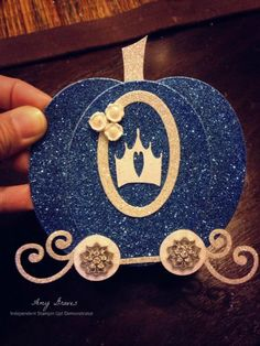 Cinderella's carriage made from ovals, vine, and circles.