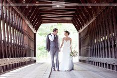 Bride and groom looking adorable on the covered bridge before their rustic wedding at the Woodstock Inn in VT...