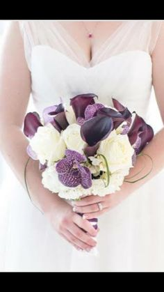 Stunning bridal bouquet of eggplant calla lilies, vanda orchids, white roses and hydrangeas