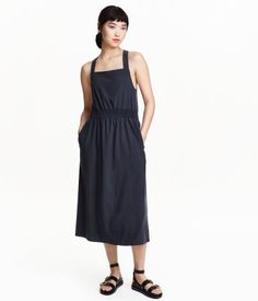 Calf-length dress in a lyocell blend with a silky matt finish, wide shoulder straps, smocking at the waist and a draped wrapover detail at the back.
