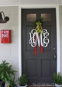 "Inexpensive website to order monogram wood letters. // I also like the ""post"" box and the door color."