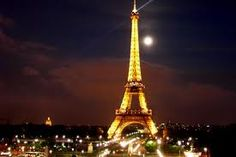 The eifful tower at night. I want to go there someday.
