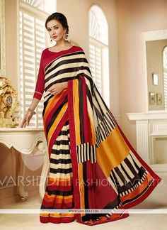 This delightful diva accoutre features unique styling and unusual material. Add grace and charm to your appearance in this beautiful multi colour pashmina and silk casual saree. Look ravishing clad in...