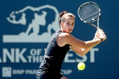 Jarmila Gajdosova of Australia returns a shot to Michelle Larcher De Brito of Portugal during the Bank of the West Classic at Stanford University Taube Family Tennis Stadium on July 9, 2012 in Stanford, California.