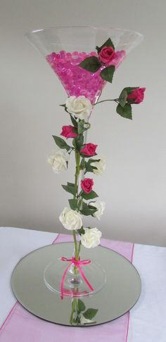 70cm Martini vase decorated with roses, with hot pink gel balls and lights