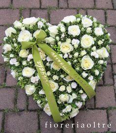 Fioreria Oltre/ Fresh flower heart shape arrangement/ Sympathy heart/ Funeral heart/ White roses and spray roses, greenery   https://it.pinterest.com/fioreriaoltre/fioreria-oltre-in-loving-memory/