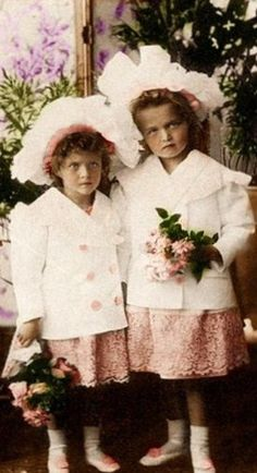 Grand Duchesses Olga Nikolaevna (right) and Tatiana Nikolaevna holding flowers, 1899. #Russian #history #Romanov