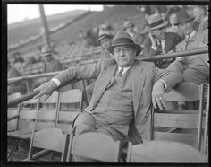 St. Louis Cardinals general manager Branch Rickey sitting in the first base box seats at Braves Field 1938.