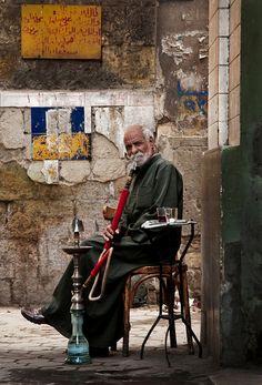 Man smoking shisha outside an ahwa in the Darb-al-Ahmar residential district.
