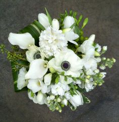White Bouquet Calla Lily Greenery Orchid Rose Tulip Wedding Flowers Photos & Pictures - WeddingWire.com