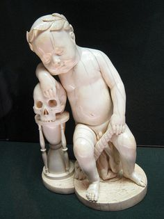 Medieval sculpture of Infant and Skull,   Louvre Museum