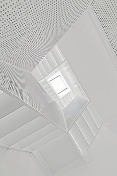"""This perforated steel staircase was designed to make climbing to the top feel like """"walking into the sky""""."""
