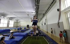 A 5-year-old girl reacts as she practices diving posture during a diving training session at a training center in Beijing July 27, 2011.  REUTERS/Jason Lee