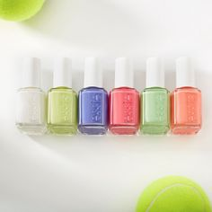 Beauty News: Essie Releases Have A Ball Nail Polish Collection - Where To Buy Essie has just released their newest nail polish collection — the new Essie Have A Ball Collection. The new assortment of nail colors is inspired by spring pastels and tennis. There are 6 shades in the Have A Ball Collection: a white shade, a tennis yellow, a periwinkle purple, a coral pink, a minty green, and an orange peach. The new Essie Have A Ball Nail Polish Collection... Coral Pink, Periwinkle, Purple, New Nail Polish, Nail Polish Collection, Beauty News, Beauty Industry, Orange, Yellow