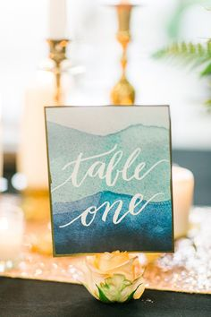 We adore the bold turquoise on these eye-catching watercolour table numbers.