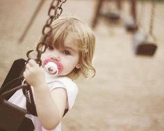 Cute little kid in swing