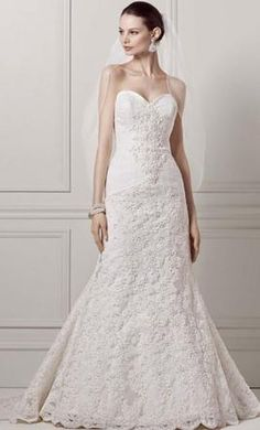 Oleg Cassini 4: buy this dress for a fraction of the salon price on PreOwnedWeddingDresses.com