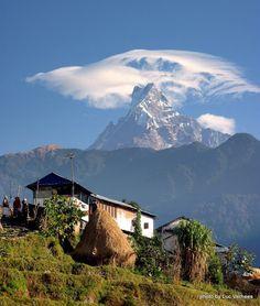 Village view of the holy mountain of Machhapuchhre in Nepal 3078 māchā माछा fish macha n. 2446 pucchara पुच्छर tail n.