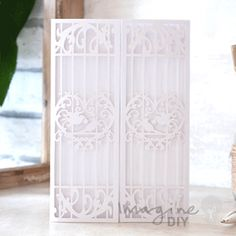 Birdcage Laser Cut Range in White  Laser cut wedding invitations perfect for your luxury wedding. DIY laser cuts are easy and elegant with options to insert your own printer inserts.