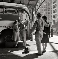 """""""Greyhound Goodbye"""" Soldiers with their girls at the Indianapolis Bus Station saying goodbye. September 1943"""
