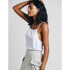 """❤️️SALE❤️ NWOT Easy Breezy Ribbed Tank Brand new. White. Square neck line. Low scoop back. Flowy and oversized.  21.5"""" L 38"""" bust  Very soft 65% Polyester 35% Rayon Free People Tops Tank Tops"""